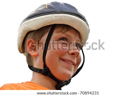 A young boy wearing his bike helmet, ready to ride. - stock photo