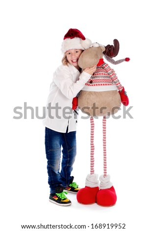 A young boy with a Christmas Reindeer. - stock photo