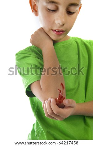a young boy with a painful elbow on white - stock photo