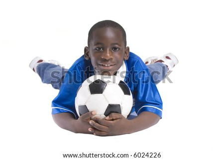 A young boy with a soccer ball. isolated on white - stock photo