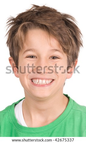 A young boy with white teeth smiling - stock photo