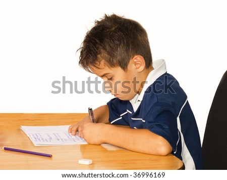 A young boy working on his studies at home