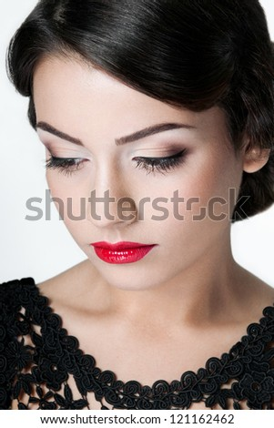 A young brunette with red lips