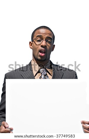A young business man holds up a blank white sign with copyspace. - stock photo