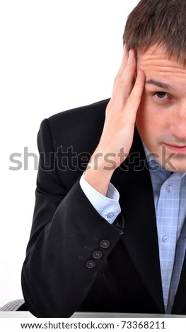 A young business man man thinking - stock photo