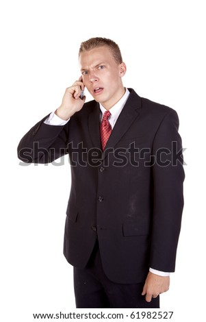a young business man on his cell phone getting mad at the person his is listening to. - stock photo