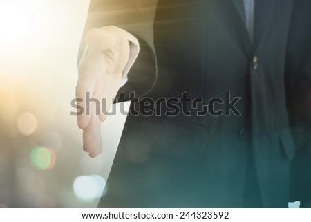 A young business man ready to shake hands