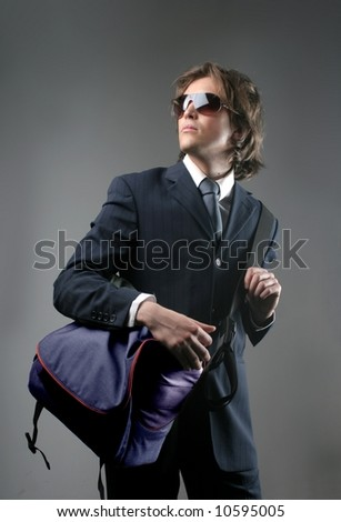 a young business man with a bag - stock photo