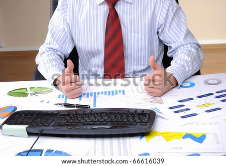 A young business man working in an office at his workplace.