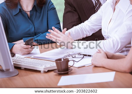 A young business team in the office - stock photo