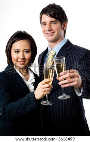 A young businessman and businesswoman celebrating their success with champagne on white background (focus on glasses)