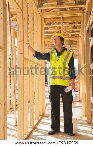 A young businessman at the construction site - stock photo