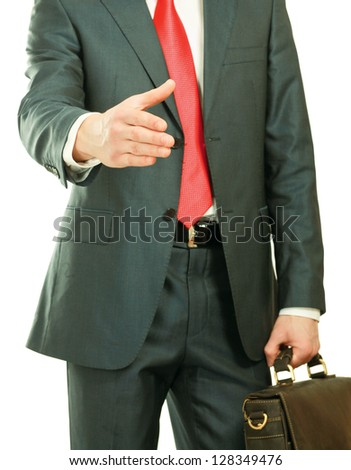 A young businessman giving his hand for a handshake, isolated on white background - stock photo