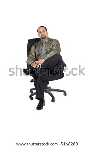 A young businessman in an office chair - isolated on a white background - stock photo