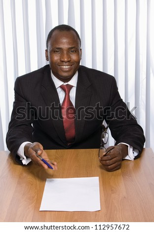A young businessman in the office isolated on white background