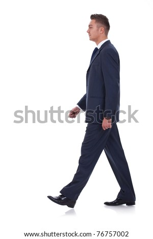 A young businessman is walking. He is smiling and looking away from the camera. isolated over white background - stock photo