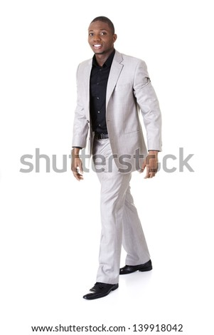A young businessman is walking. Isolated over white background - stock photo