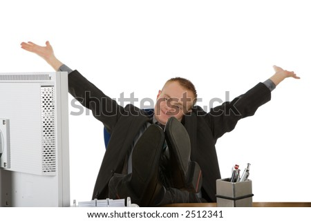 a young businessman jubilate in the office with white background,focus on the feet