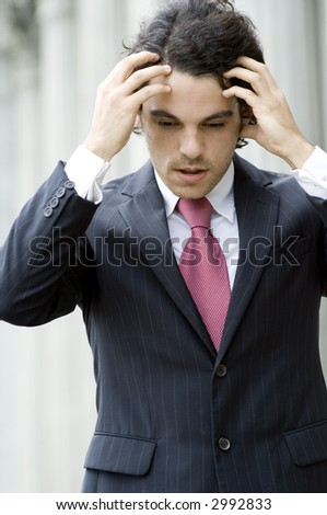 A young businessman looking stressed