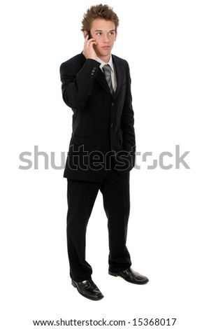 A young businessman on his pda device - stock photo