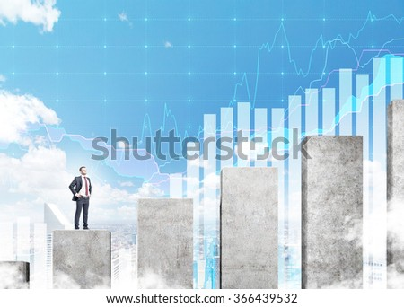 A young businessman standing on a career ladder in shape of a concrete bar chart, blue sky and blue graphs at the background. Concept of career growth. - stock photo