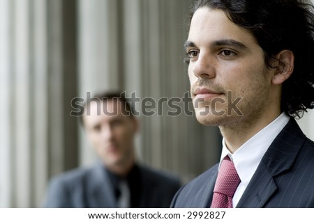 A young businessman with another out of focus in background