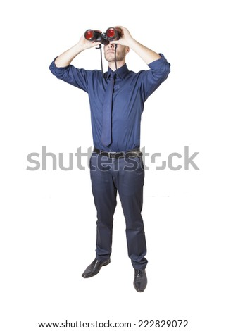 a young businessman with binoculars isolated on a white background - stock photo