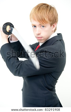 a young businessman with japanese sword