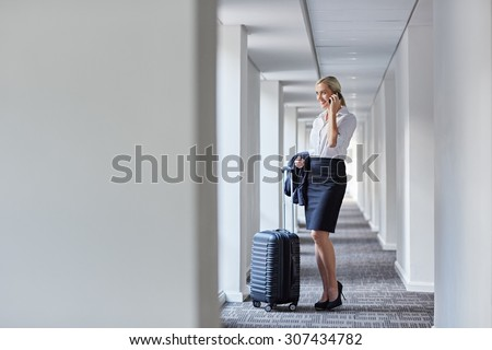 A young businesswoman about to take a business trip - stock photo