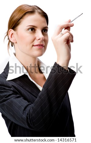 A young businesswoman pointing with a stylus - stock photo