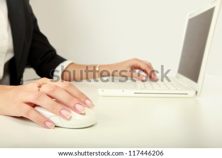 A young businesswoman working on a laptop - stock photo