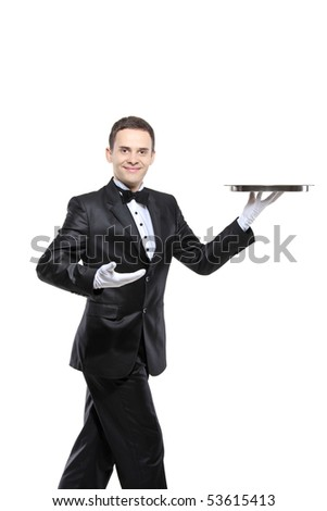 A young butler carrying a tray isolated on white background - stock photo
