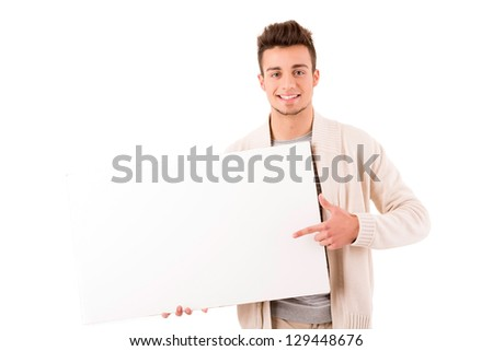 A young casual man holding a white card - stock photo