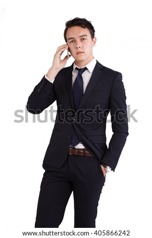 A young caucasian male businessman looking unhappy holding a mobile phone looking at camera.