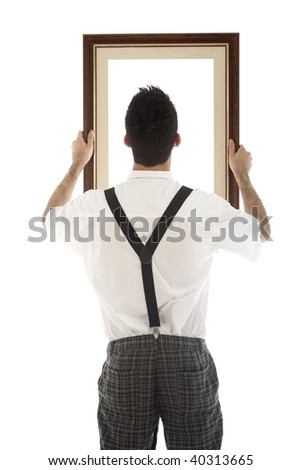 A young, caucasian nerd, holding up a frame, isolated on a white background. - stock photo