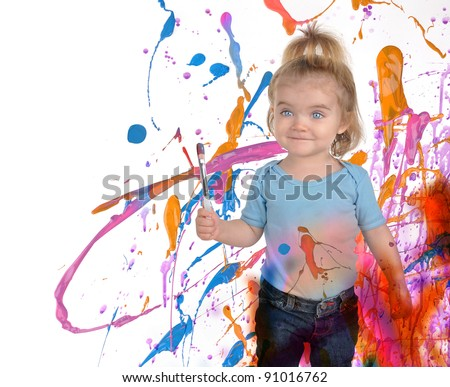 A young child is painting splatters of messy paint on a white background. Use it for a art or creativity concept.