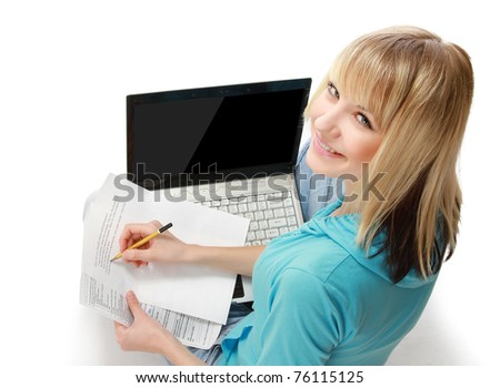 A young college girl studying, back-view - stock photo