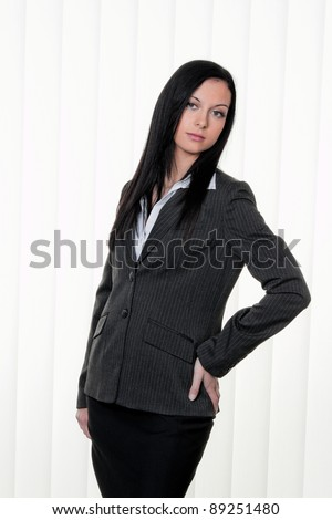 a young, confident business woman in business attire