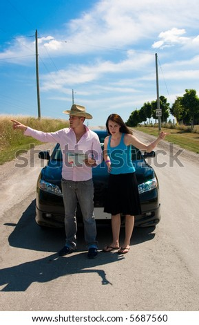 A young couple argues on which way to go