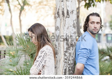 A young couple back to back after a fight - stock photo