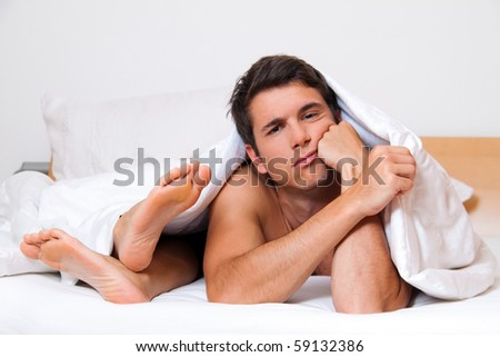 A young couple in bed having problems and crisis. Divorce and separation. - stock photo