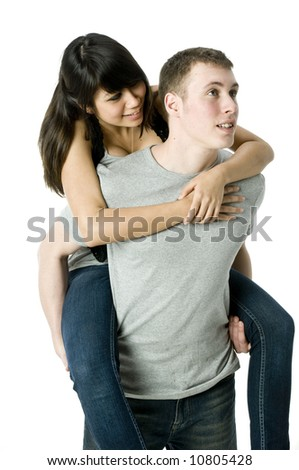 A young couple in love having a piggyback ride
