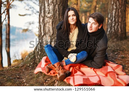 a young couple in love in the park in winter - stock photo