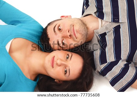 A young couple lying on the floor