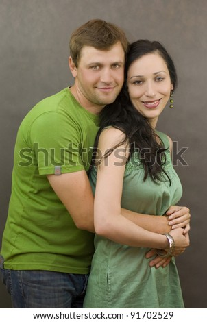 A young couple posing in studio - stock photo