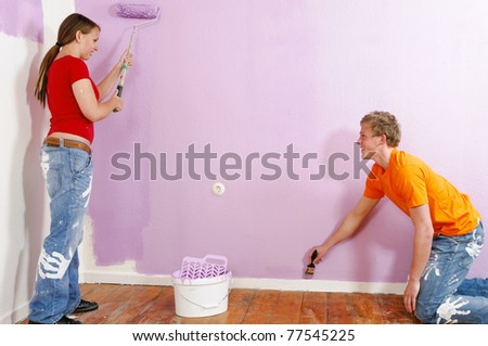 A young couple renovated their first home together. They emphasize a lot of fun with the walls with paint roller and paint.