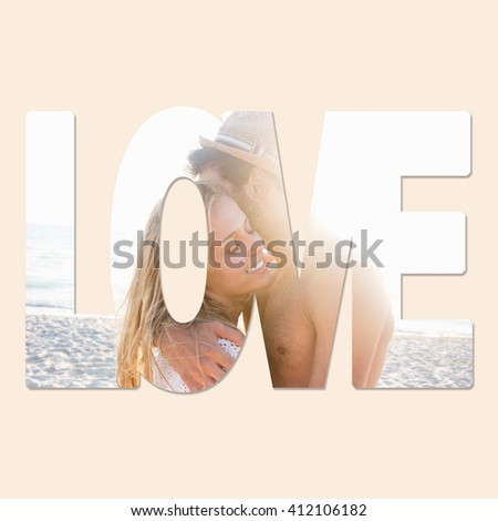 A young couple showing their love on a beach at summer - stock photo
