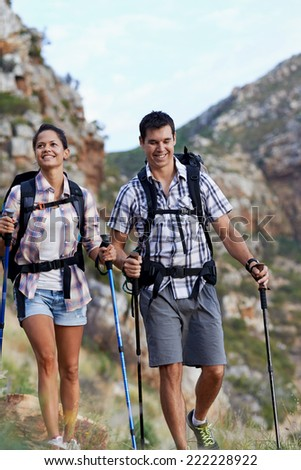 A young couple walking along a hiking path - stock photo