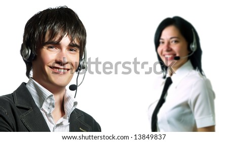A young customer service representative man and a lady are smiling. They have headphones and they are wearing elegant shirts. - stock photo