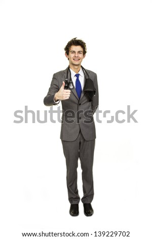 A young doctor dressed in a suit looking confident isolated against a white background.